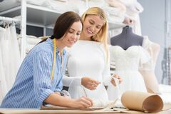 Seamstress Working With Customer Stock Image