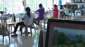 Seamstresses work at the garment factory in Ha Noi stock video footage