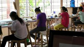 Seamstresses work at the garment factory in Vietnam stock video footage