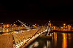 Sean O`Casey Bridge. Is  pedestrian bridge, shot  at night, with light reflection on river Stock Photos