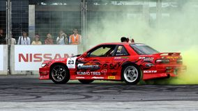 Sean performing donuts in his red sedan Stock Images