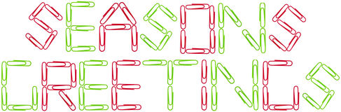 Seanson's greetings red and green paper clips stock photos
