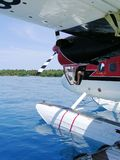 Seaplane. A De Havilland twin otter, at a floating dock in the Maldives front door open, pilot is wearing sandals stock image