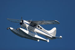 Seaplane. Over the blue sky Stock Images