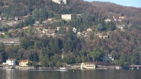 Seaplane aircraft takes off from water aerodrome of Como, Italy. Seaplane aircraft floats on the water and takes off from Water Aerodrome of Como lake, Lombardy stock video footage