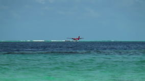 Seaplane on background water surface and horizon in Maldives. Pleasant journey into the world of beautiful nice nature. A unique landscape stock video