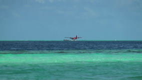 Seaplane on background water surface and horizon in Maldives. Pleasant journey into the world of beautiful nice nature. A unique landscape stock footage