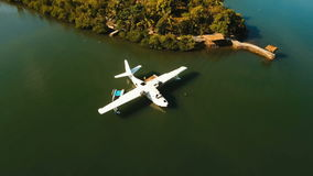 Seaplane in the bay. Busuanga, Palawan, Philippines. Aerial view: White Seaplane parked in the sea bay of the tropical island. Hydroplane in the lagoon and stock video footage