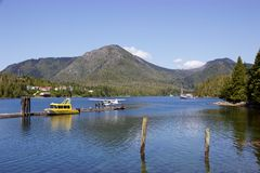 Seaplane and boat docked at Hot Springs Cove, Tofino, Canada Royalty Free Stock Photography