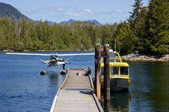 Seaplane and boat docked at Hot Springs Cove, Tofino, Canada Stock Photos