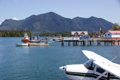 Seaplane, boats docked in Tofino harbour on sunny spring day Stock Photography