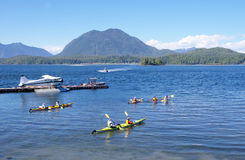Seaplane, boats and five kayaks in Tofino port  Va Royalty Free Stock Photo