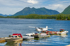 Seaplane and Boats moored to a Floating Pontoon Stock Photo