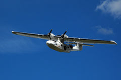 Seaplane Catalina on blue sky Royalty Free Stock Image