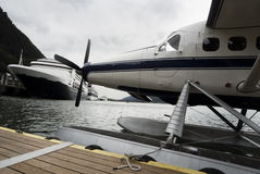 Seaplane and cruise ships docked along the pier in Alaska royalty free stock image