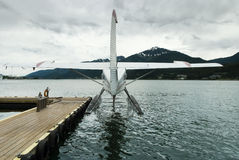 Seaplane docked at the port of Juneau with storm clouds overhead Royalty Free Stock Photo