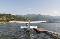 Seaplane docking on at water aerodrome of Como lake, Italy Royalty Free Stock Photos