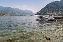 Seaplane and ducks on Como lake, Italy Stock Photos