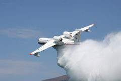Seaplane firefighter dropping water Royalty Free Stock Photos
