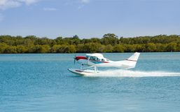 Seaplane Floatplane Takeoff. A floating Seaplane speeds up to take off on a sightseeing excursion on the New South Wales Coast, Australia Stock Photography
