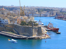 Seaplane flying over Valletta harbour Stock Photos