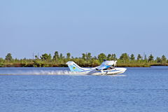 Seaplane L-42M glides through the water Stock Images
