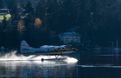Seaplane on lake or river Royalty Free Stock Image