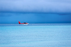 Seaplane landing on the sea Royalty Free Stock Images
