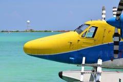 Seaplane landing on Turquoise water. Seaplane landing on the Crystal Turquoise water royalty free stock photography