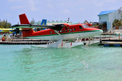 Seaplane landing on water port over turquoise water, Maldives Stock Image