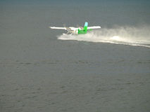 Seaplane makes a landing. royalty free stock photography