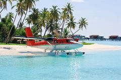 Seaplane near tropical island Stock Images