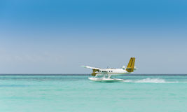 Seaplane over blue ocean Royalty Free Stock Photography