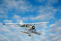 Seaplane over the clouds Royalty Free Stock Photo
