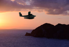 Seaplane over exotic island Royalty Free Stock Photos