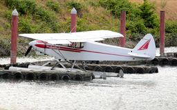 Seaplane parked at the dock. Stock Photos