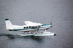 Seaplane preparing for takeoff in water Royalty Free Stock Photo