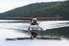 The seaplane reflected on the lake stock photos