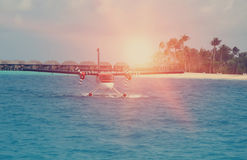 Seaplane at the sea near the island with palm trees, Stock Photography