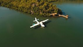 Seaplane on sea water surface. Aerial view white Seaplane in sea bay. hydroplane on the water surface near the shore Travel concept, Aerial footage stock video