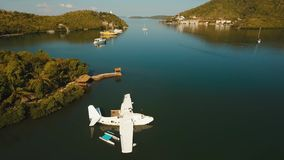Seaplane on sea water surface. Aerial white Seaplane in the sea bay. hydroplane on the water surface near the shore Travel concept, Aerial footage stock video