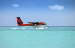 Seaplane soft landing on turquoise ocean Royalty Free Stock Photos