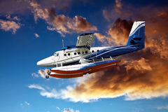 Seaplane and stormy clouds Royalty Free Stock Photography