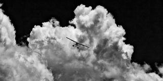 Seaplane in stormy skies above Sydney, Australia Royalty Free Stock Images