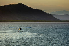 Seaplane at Sunrise Cairns Harbor Stock Images