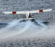 Seaplane Takeoff. Ketchikan, AK, USA - May 24, 2016: A seaplane revs spray for an aquatic take off royalty free stock photo