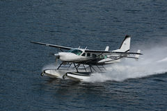 Seaplane Takeoff. Ketchikan, AK, USA - May 24, 2016: Seaplane sprays from acceleration for takeoff stock photography