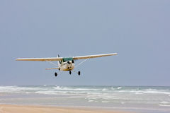 Seaplane taking off from beach Stock Photography