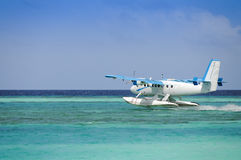 Seaplane taking off over blue ocean Royalty Free Stock Photos