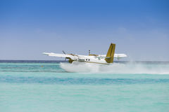 Seaplane taking off over ocean Royalty Free Stock Image